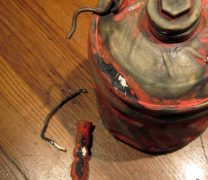 red ceramic gas can with broken handle