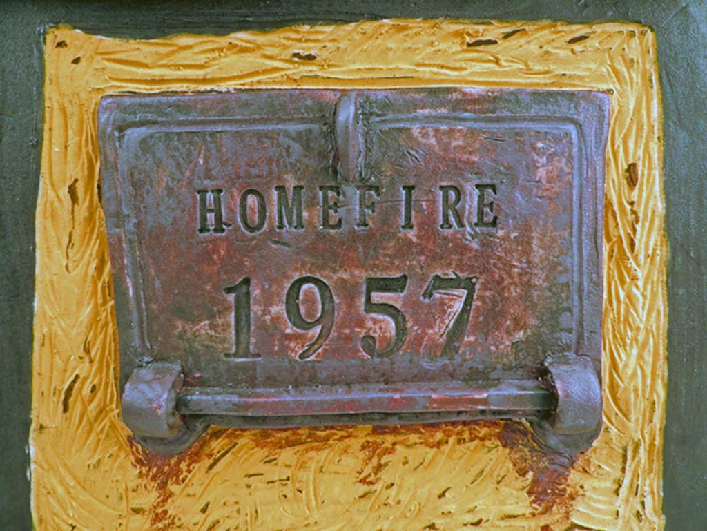detail of ceramic incinerator door with Homefire 1957 impressed into clay