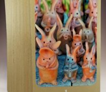 "Desert Wisdom Card ""play"" with image of pottery jackrabbits"