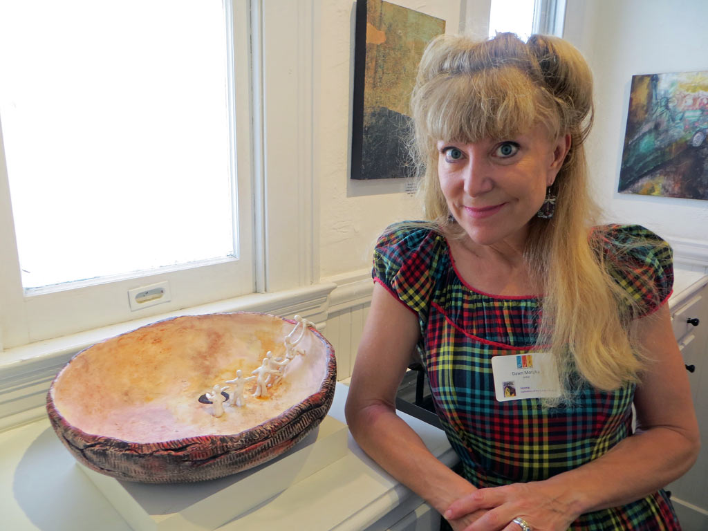 "Dawn Motyka with her ceramic bowl ""Sipa Pu: Hopi Creation Myth"""