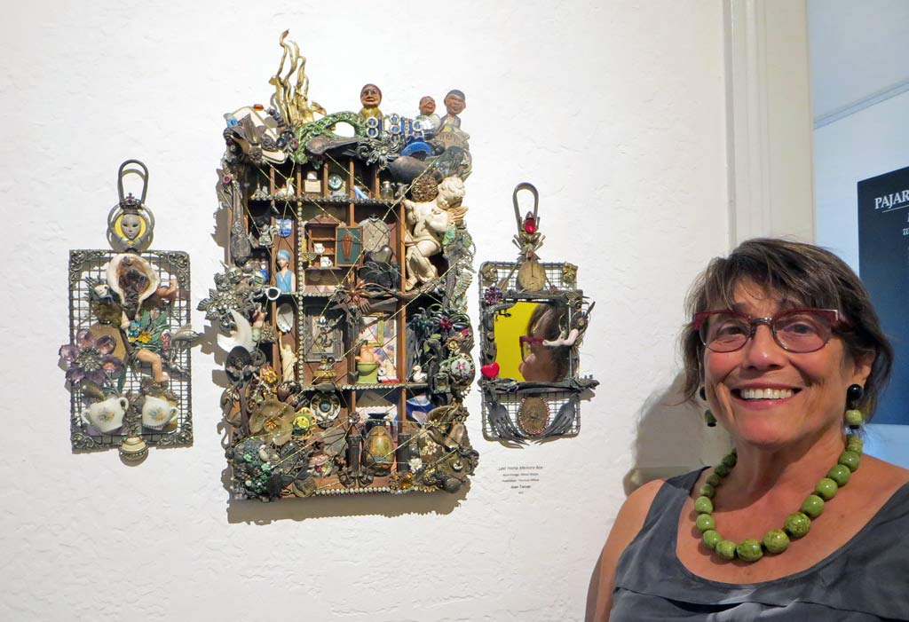 "Joan Tanzer standing next to her assemblage artwork titled ""Lost Home Memory Box"""