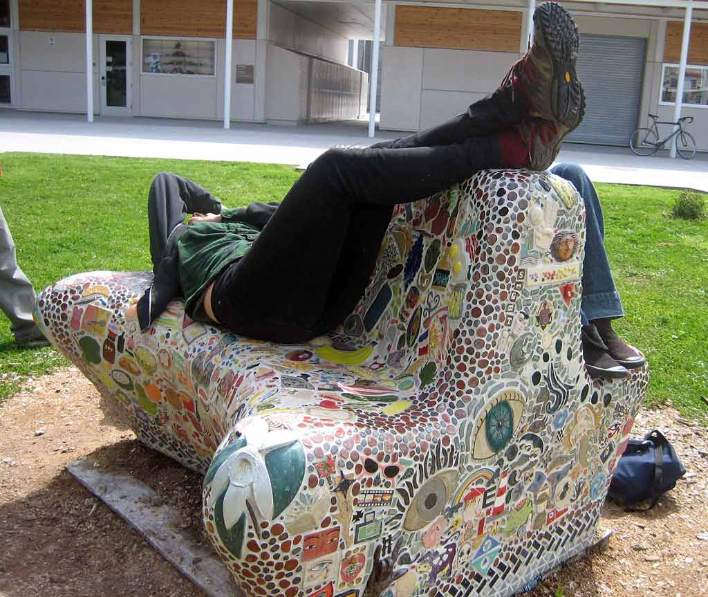 Students using mosaic bench