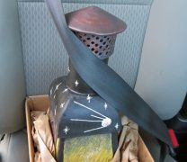 Ceramic Incinerator Boxed and Buckled Into A Seatbelt