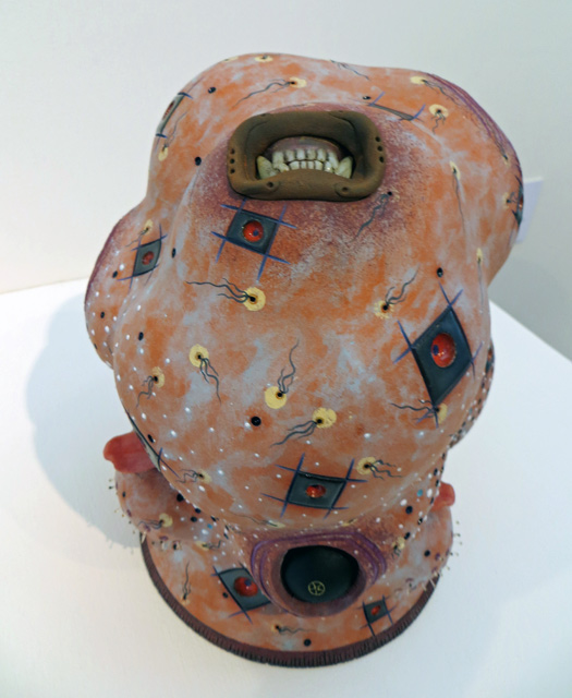 ceramic sculpture in blob form with small shapes by Brad Blair