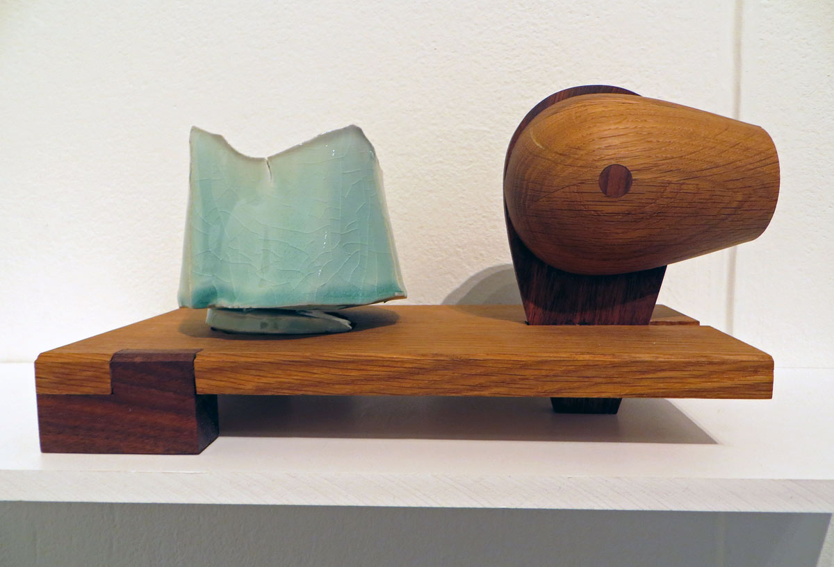 celadon teabowl with sculptural wooden display support