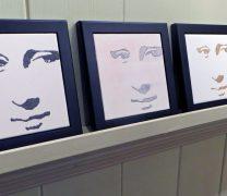 Four framed hi contrast ceramic tiles of Mona Lisa's face.