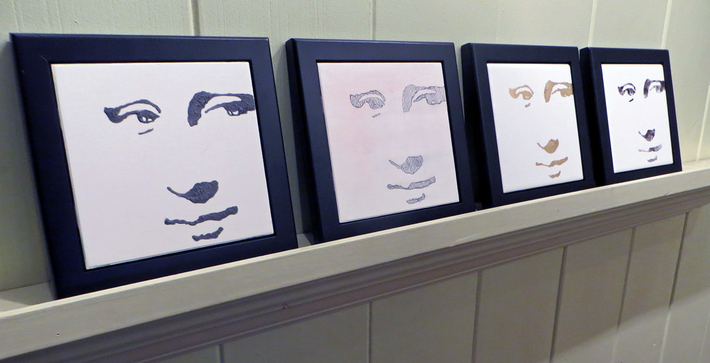 Four framed hi contrast ceramic tiles of Mona Lisa's face.