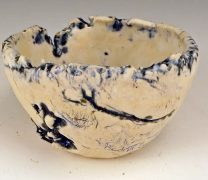Small hand formed wabi sabi ceramic bowl.