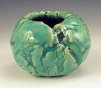 Celadon glazed cracked pinch pot