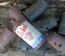 Ceramic Pabst Beer Can on Nest of Rusty Shot up Cans