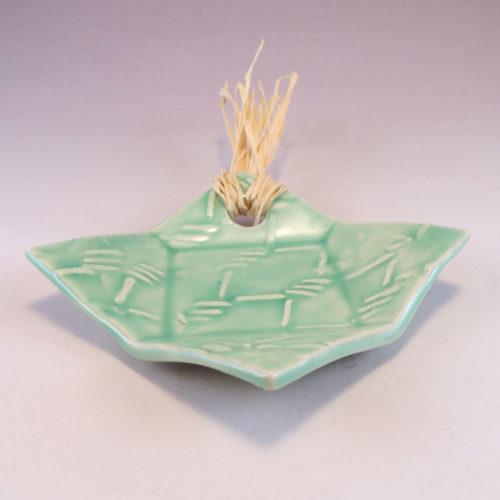 small aqua dish with raffia
