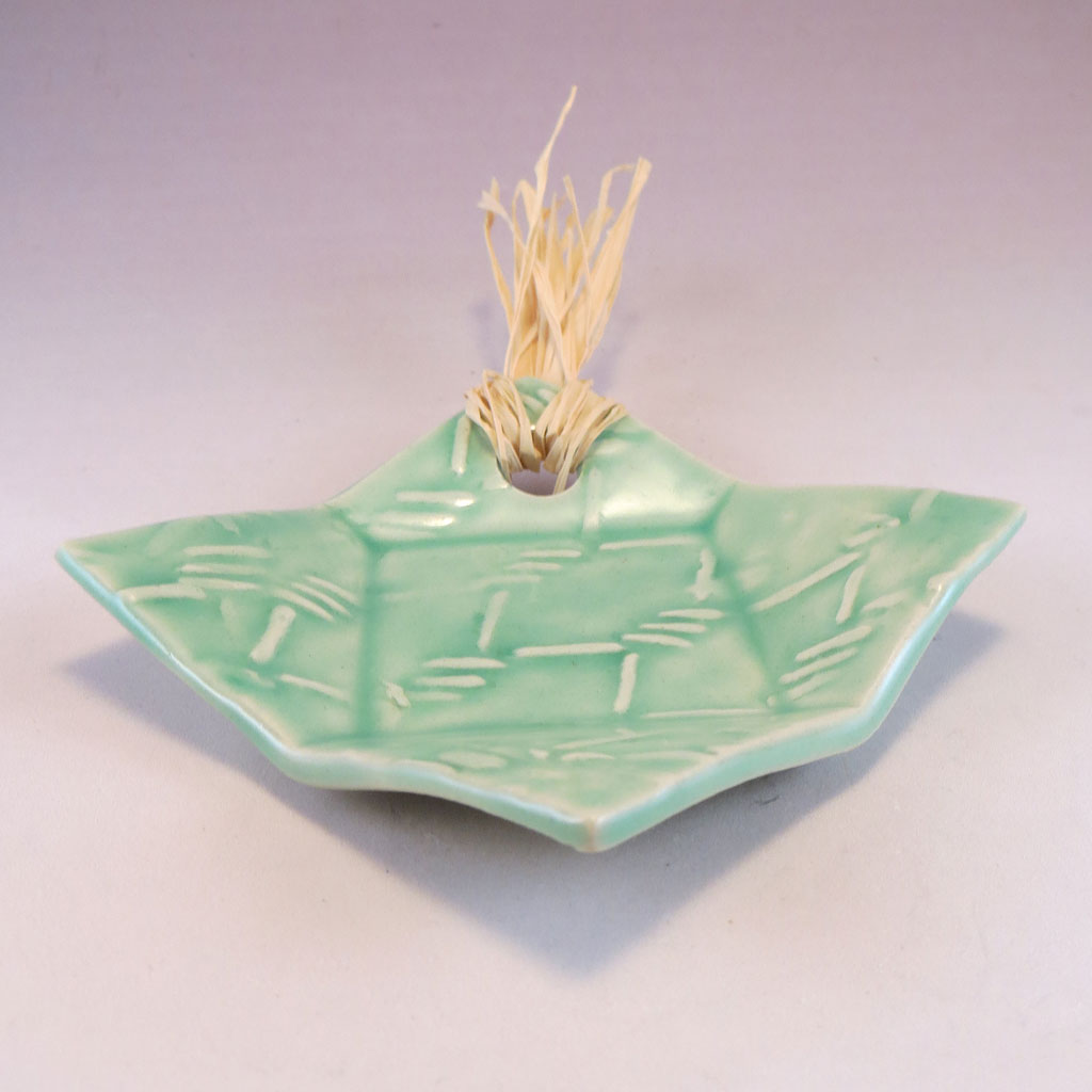 small aqua dish with raffia