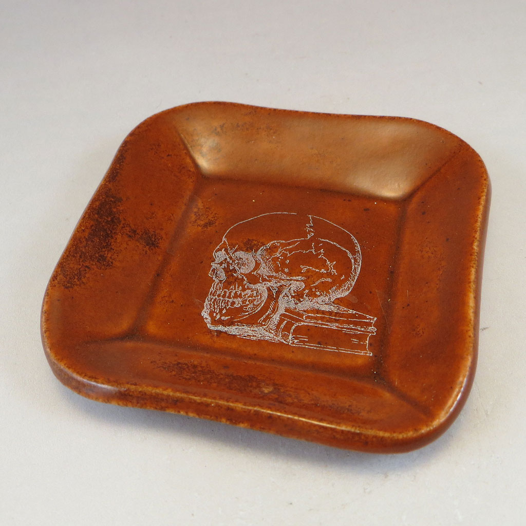 Burnt Orange dish with skull decal top side