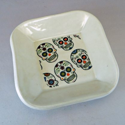 White dish with sugar skull decal top angle