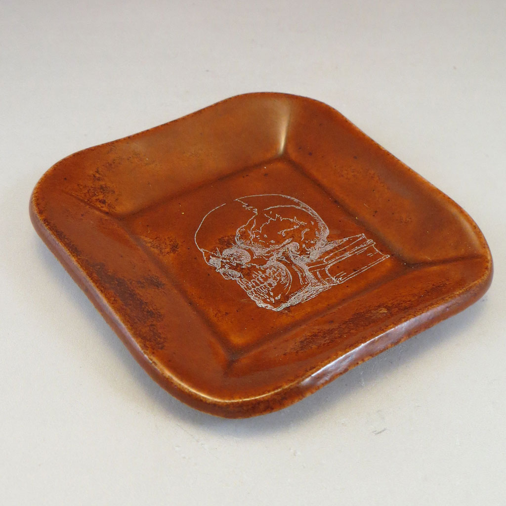 Burnt Orange dish with skull decal side angle