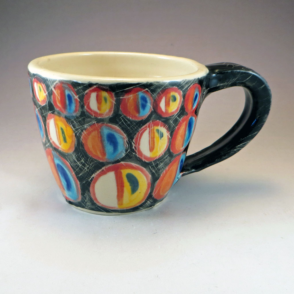 ceramic mug with colorful circle decoration